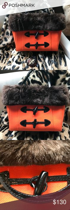 """Kate Spade winter wonder land hand bag Adorable brown faux fur trim black patient Leather toggles.Orange wool Kate Spade. 3 separate compartments. Slip pockets.Zip pocket black and white striped interior. Gold hard wear. Projective gold feet. Gently used. Slight scuffs on toggles. EUC please see pictures for description. 10"""" height 13"""" width kate spade Bags Satchels"""
