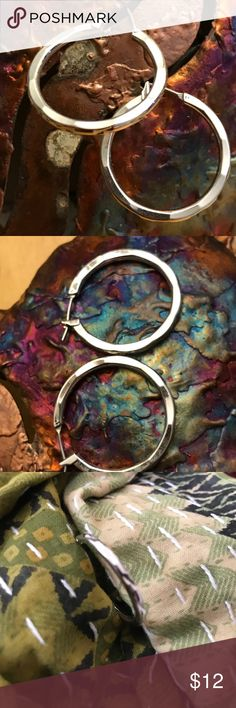 "Lia Sophia Silver Hoop Earrings Worn a few times, perfect condition.  ""X"" design and a bit of hammered appearance makes it shine.  1"" diameter Lia Sophia Jewelry Earrings"