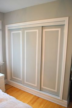 Closet Door Ideas: Add interest to plain closet doors by painting them and adding a trim detail in an accent color. Two-Tone Closet Door Tutorial. Hmm cheap way to redo our ugly closet doors Sliding Closet Doors, Sliding Wardrobe, Wardrobe Doors, Wardrobe Closet, Sliding Cupboard, Cupboard Doors, Closet Space, Diy Interior, Interior Barn Doors