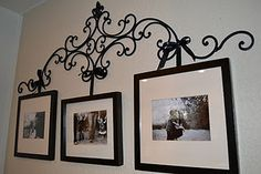 Wrought iron picture hanger with upcycled frames. Put to better use things you already have!