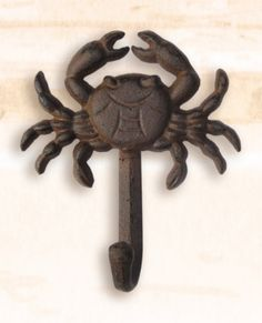 """Iron Crab Clothing Hook Antiqued. Handy as can be onboard the boat, in the shop: anywhere indoors, or out. We call this one the """"Happy Crab"""". Cast iron antique dark brownish finish.Nautical by nature. Vintage Rustic Cast Iron Hook has hardware installed on back to mount to wall. Measurements: 5"""" tall x 4.5""""wideand hook is 1.5"""" out from wall. Weight: 6 oz. Coastal or Beach House Wall Hooks:their stylish maritime design are also used…"""