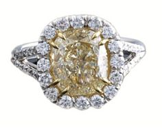 A platinum, white and fancy yellow diamond ring. Set in the center is a cushion cut, 3.02 carat, fancy yellow diamond | Keller & George
