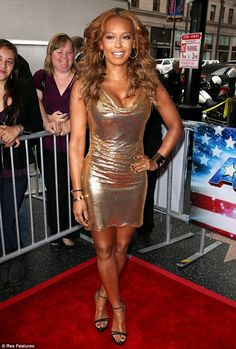 High drama: Mel B wore her highlighted brown hair in volumised curls over her shoulders, and opted for a smokey eye and nude lips