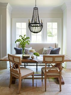 a beaded chandelier and mixed seating add interest to a dining space