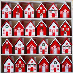 "Each of the tiny, hand-crafted houses in this Advent village is fitted with a removable roof that allows small, special gifts to be stowed inside and mark the days until Christmas.- Set of 24- Wood- Set includes white wooden display crate- Imported13""H, 13""W, 2.75""D"