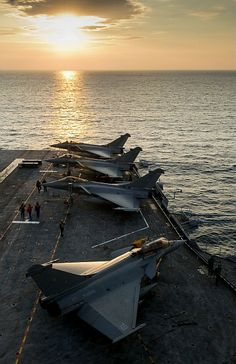 French Marine National Dassault Rafale Ms (Marine) on board aircraft carrier (port avions in French parlance) Charles de Gaulle off the coast of Lybia, during Opération Harmattan.