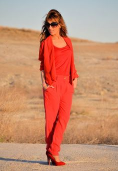 LADY IN RED! Very red. Trouser, top even shoes!