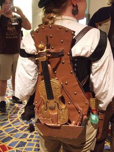 10 Steampunk Backpacks, including this violin crossbow.