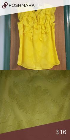 Yellow Shirt This yellow shirt has lightly imprinted flower designs on it and has never been worn. Tops Blouses