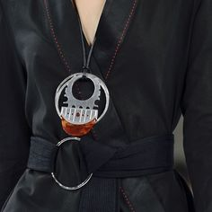 Edun showed off this necklace from their global  collection.  I love the mix of the graphic silver with the organic tortoise.