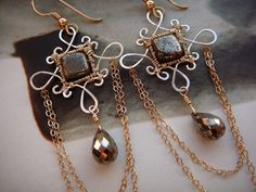 Iron Lady filigree earrings  sterling silver by CleopatraKerckhof