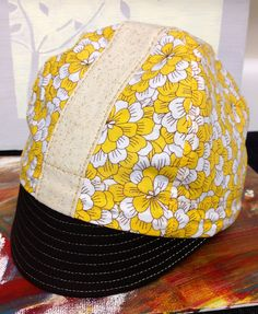 366a355f2e2 sparkling champagne and yellow floral cycling cap for toddlers.  25.00