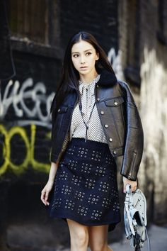 [COACH] Angelababy. Black leather jacket. Black skirt with stud detailing.