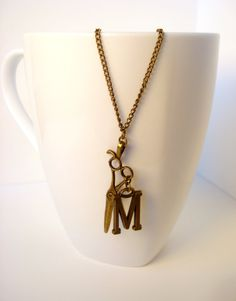 $13.00 Personalized Initial Bronze Scissors Necklace, this has been really popular with hairstylists