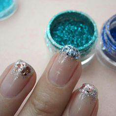 They sell variety color pack of glitter just for nails at Sally's Beauty Supply. Fun.