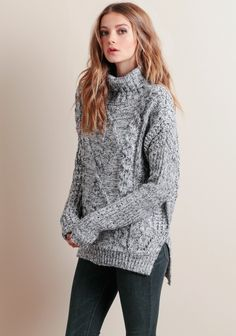 A must-have during these cooler months ahead, this oversized sweater features a chunky cable knit design in hues of cream, slate, and navy. Complete with a turtleneck, drop-shoulder sleeves, and ...