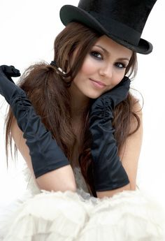 Victoria Justice wearing satin gloves.