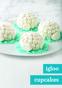 """Igloo Cupcakes – Wanna be the coolest mom or dad on the block? Bring these fun Igloo Cupcakes to the next bake sale or team fundraiser this winter! Kids and adults alike will be impressed by their festive look. For an """"icy"""" lawn for your igloo, mix water and blue food coloring together. Pour on top of BAKER'S ANGEL FLAKE Coconut in a resealable bag and shake until the coconut is evenly tinted."""
