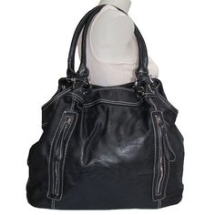 Made from soft textured faux leather. Silver-tone hardware. Dual front zip wall pockets. Back zip wall pocket. Dual carrying handles with over-sized hardware. Zip top