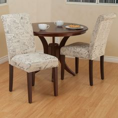 These dining chairs will add a unique flair to your dining space. Designed with French handwritten pattern over beige linen, these chairs will certainly be a conversation starter to any entertaining occasion.