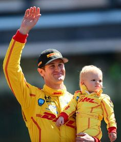 Ryden Hunter-Reay joins Dad in Victory Lane @ 2014 Indy 500. He wore the fire suit but absolutely denied even sampling from the winner's bottle of milk...just like Evie Johnson and Brooklyn Newman balked at kissing the bricks when their daddies won there. (Ryder's uncle is Robby Gordon.)
