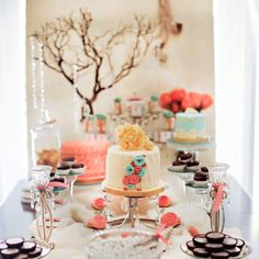 LOVE the coral in the back ground! Great height for centerpiece on food table!!  Coral and teal wedding table arrangement. Plus Reese's, can't lose with Reese's.