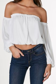 Adorable off shoulder long sleeve top with cropped elasticized hem. Lightweight chiffon material with relaxed fit. - 100% Polyester - Imported - Model is wearing size S - Runs true to size - Hand wash