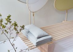 Japanese-influenced daybed featuring built-in privacy screens.