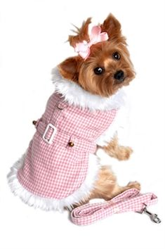Beverly Hills Pink Houndstooth and White Fur Collar Harness Dog Coat from Simply Dog Stuff, $32.  This adorable harness style coat with velcro neck and chest closures will keep your precious one cute and cozy all winter long. It comes with matching leash and d-ring for easy leash attachment. Made with super high quality wool blend for extra warmth and lined in white minky plush fur. Fiber filled for extra warmth.