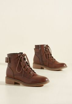 Exploration awaits at every turn with these chocolate brown boots! From urban excursions to forested footwork, the decorative buckles, faux-leather finish, and treaded rubber soles of this lace-up pair have their 'eyelets' set on adventure.