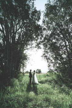 This bohemian beach wedding featured a post-ceremony forest photo shoot. (wedding photography, wedding party, bridal party, boho wedding inspiration, real wedding)