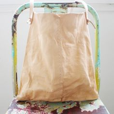 specialty dry goods: callahan - hand stitch - machine washed veg tan leather, air dried on clothes line.