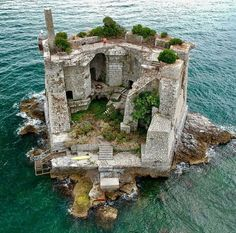 Man's Impact on the Environment Torre Scola Scola, Palmaria, Porto Venere, La Spezia, Italy Credits: Norbert Frroku The Scola Tower - or tower of St. John the Baptist - is a former military building. Abandoned Buildings, Abandoned Castles, Abandoned Mansions, Abandoned Places, Beautiful World, Beautiful Places, Beautiful Ruins, House Beautiful, Wonderful Places