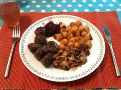 Swedish meat balls with mushrooms and red cabbage
