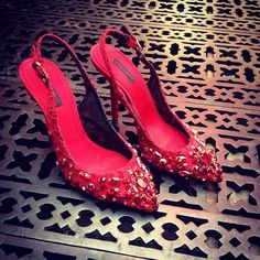 What's not to love about a jewelled lace red Dolce & Gabbana shoe?