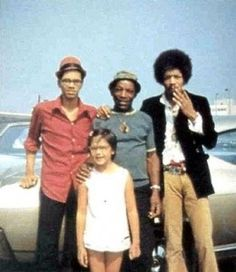 The Hendrix family. From right: Jimi, Father Al and Brother Leon. Below, little Janie.