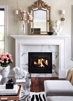 Lovely pattern in marble around gas fireplace More