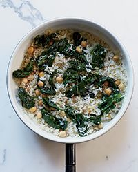 Indian Cumin Fried Rice with Spinach - F&W's Kay Chun creates a fast, vegetarian one-bowl meal by stir-frying cooked rice with chickpeas, spinach, and fragrant ginger and cumin.   Recipe on Food & Wine