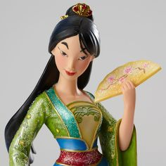 Title: Mulan Couture de Force Introduction: September 2014 Item Number: 4045773 Material: Stone Resin Dimensions: 8.125 in H x 3.1 in W x 4.5 in L Mulan sheds her armor in Disney Couture de Force, cho