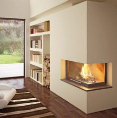 Contemporary corner fireplace (wood-burning closed hearth , retractable door) ANGOLATO THERMO New Age Stone