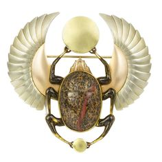 "A European Egyptian - Revival Art Deco hardstone and tri-coloured gold beetle brooch, the brooch in the form of a winged scarab beetle. ""As an ancient Egyptian symbol for resurrection, the scarab beetle has always been associated with the generative forces of the rising sun, portrayed beautifully in this brooch by the development of the small circular motif at the base to a larger one to the centre of a pair of wings representing the sun's powerful out-stretched rays."""