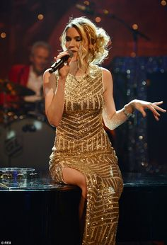 Golden girl: Joss Stone looked stunning in a festive gold gown with a thigh-high split...