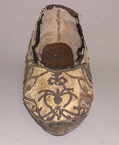 Slippers    Date:      16th century  Culture:      Italian  Medium:      leather  Dimensions:      Length: 10 in. (25.4 cm)  Credit Line:      Rogers Fund, 1916  Accession Number:      16.154.16    This artwork is not on display