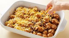 Meatballs are baked in a cheesy rice, bean and enchilada sauce mixture, which makes for a perfect twist on a weeknight dinner.