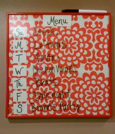 My menu board, thanks pinterest! Used a 12x12 frame and fabric inside.