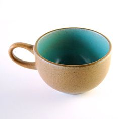 This lovely vintage piece was designed by Edith Heath and produced by Heath Ceramics of Sausalito. Its a great example of mid-century modern California