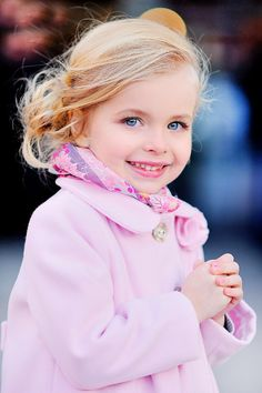 Pretty little lady...big smiles....the eyes of a child.