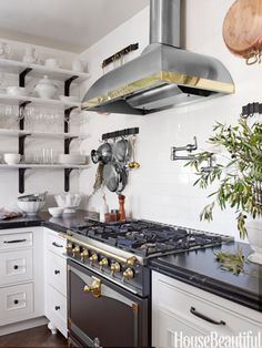 La Cornue Albertine range  I have this range in ivory... I LOVE the look.. I love the cooktop.... but seriously a frozen pizza takes an hour to bake...  the oven isn't so great!