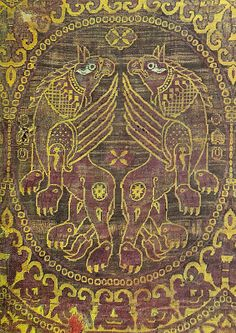 Two griffons back-to-back. 11th Century: Two griffons back-to-back. Silk serge an wool. Fragment; from a reliquary. Byzantine. Musee de Valere, Sion, France. Volbach, Early Decorative Textiles p.147