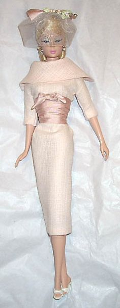 Vintage Barbie. I love her clothes and hat - that takes talent.
